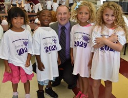 Kindergarten students receive t-shirts from Superintendent
