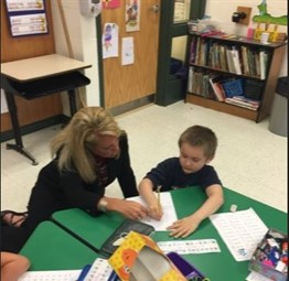 Dr. Wilson working with a Kindergarten student